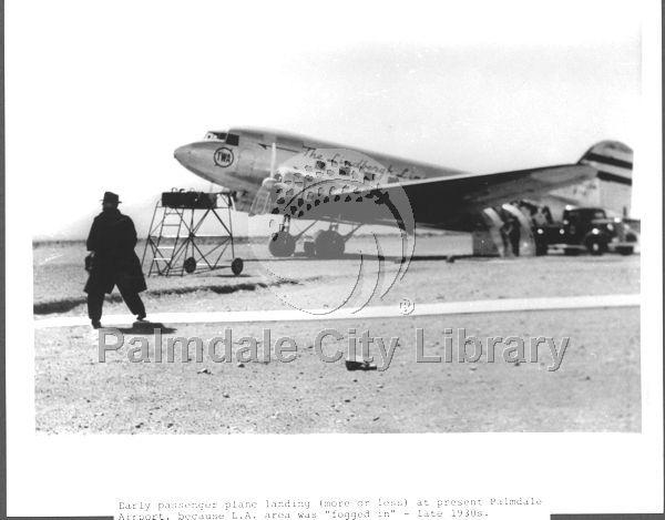 Early passenger plane landing at the airport 1930s