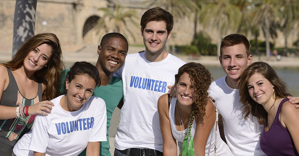 Various People Wearing Volunteer Shirts